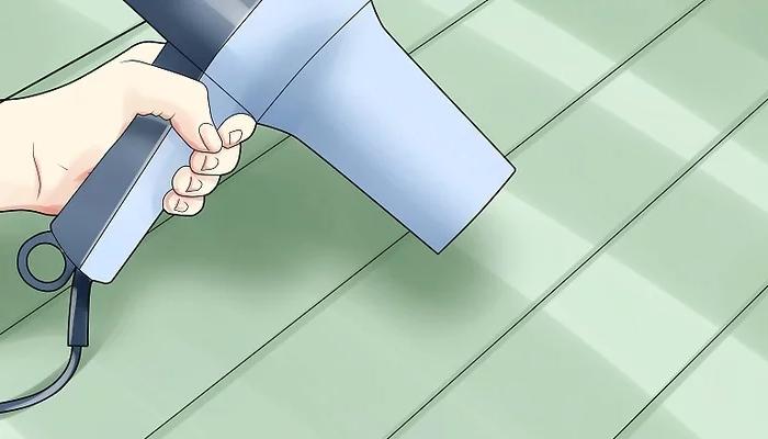 Cómo quitar pintura de la madera- pistola de calor